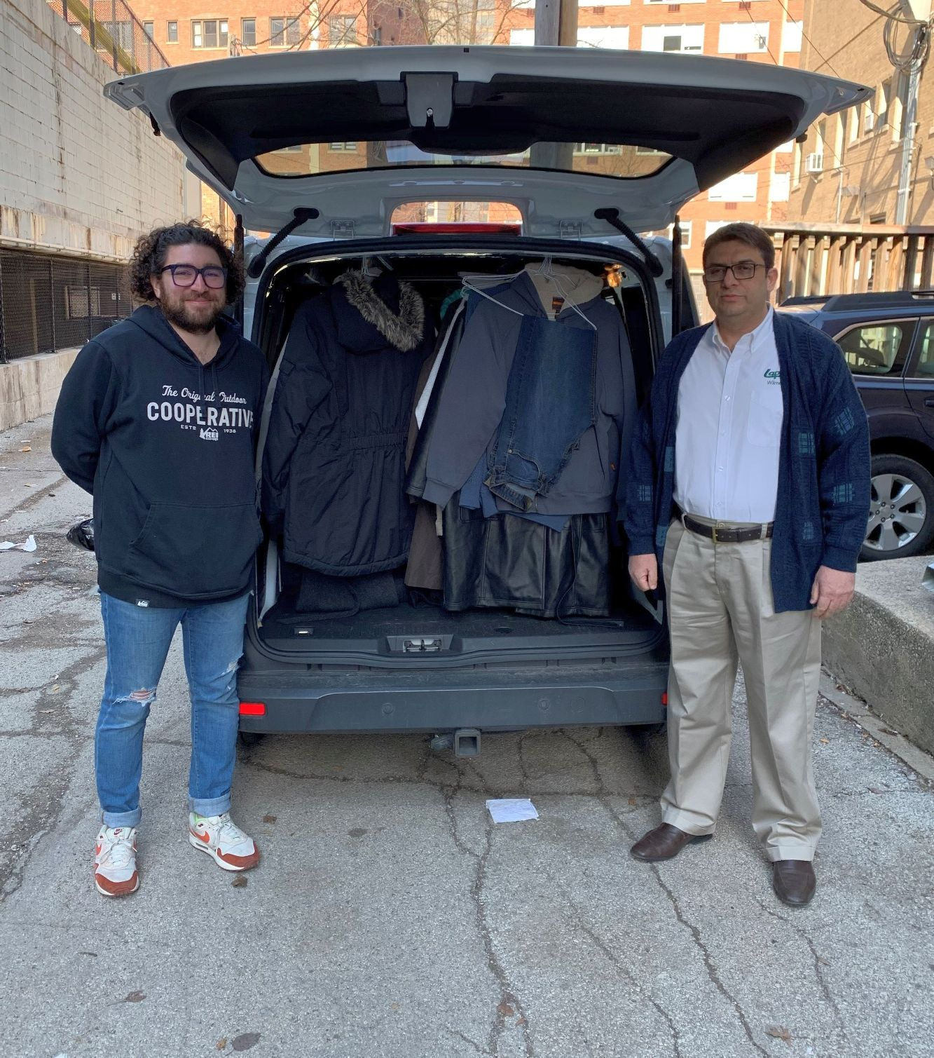 A warm clothing connection. Lapels Dry Cleaning of Wilmette wraps up winter gear drive with Connections for the Homeless