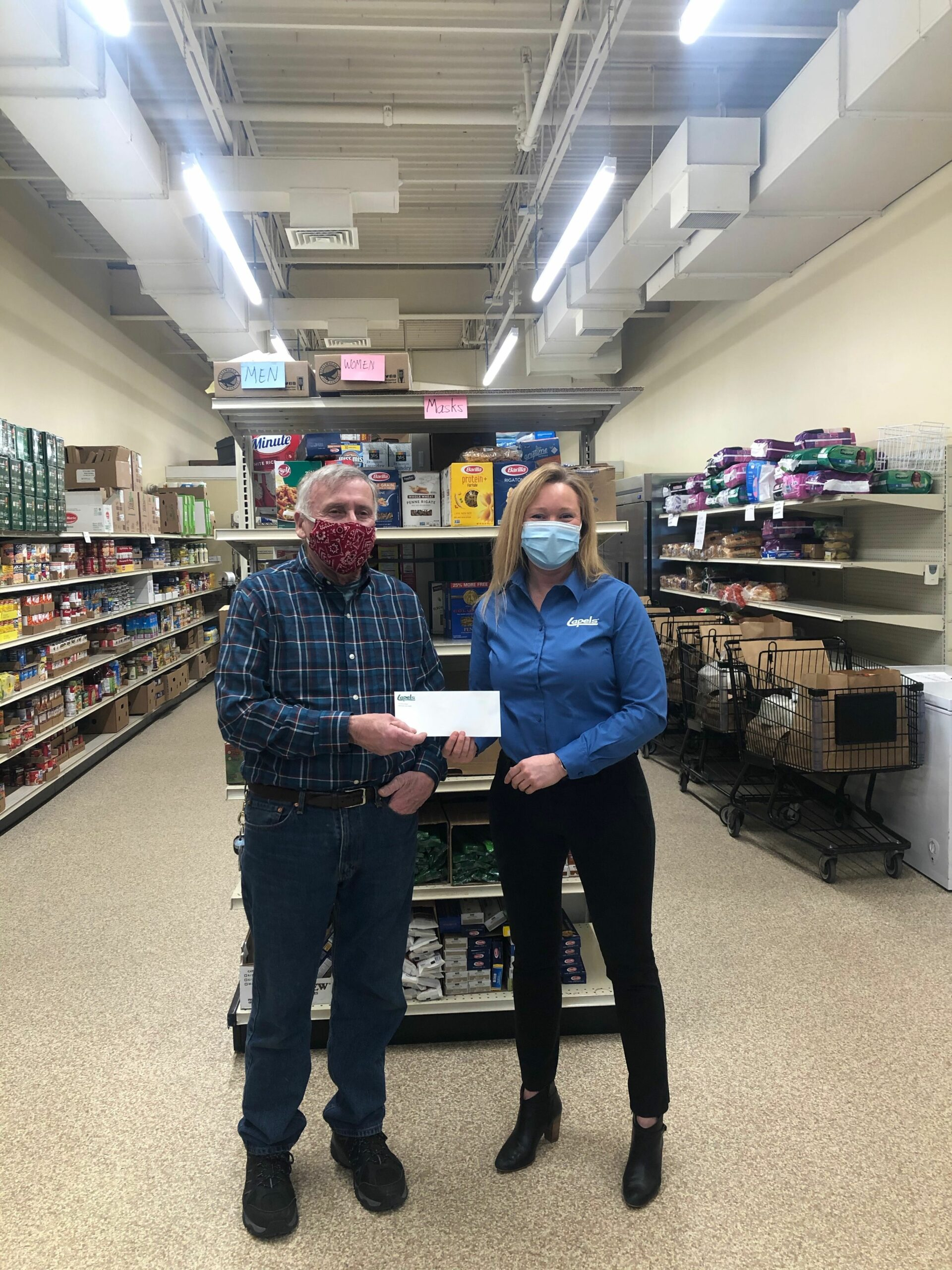 Lapels® Dry Cleaning makes donation to Marshfield Food Pantry